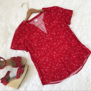 Floral patterned red shirt sleeve shirred top